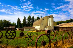 An old dairy farm with fence made from old wheels in the Palouse